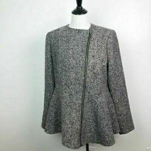 Asymmetrical zip with peplum coat.